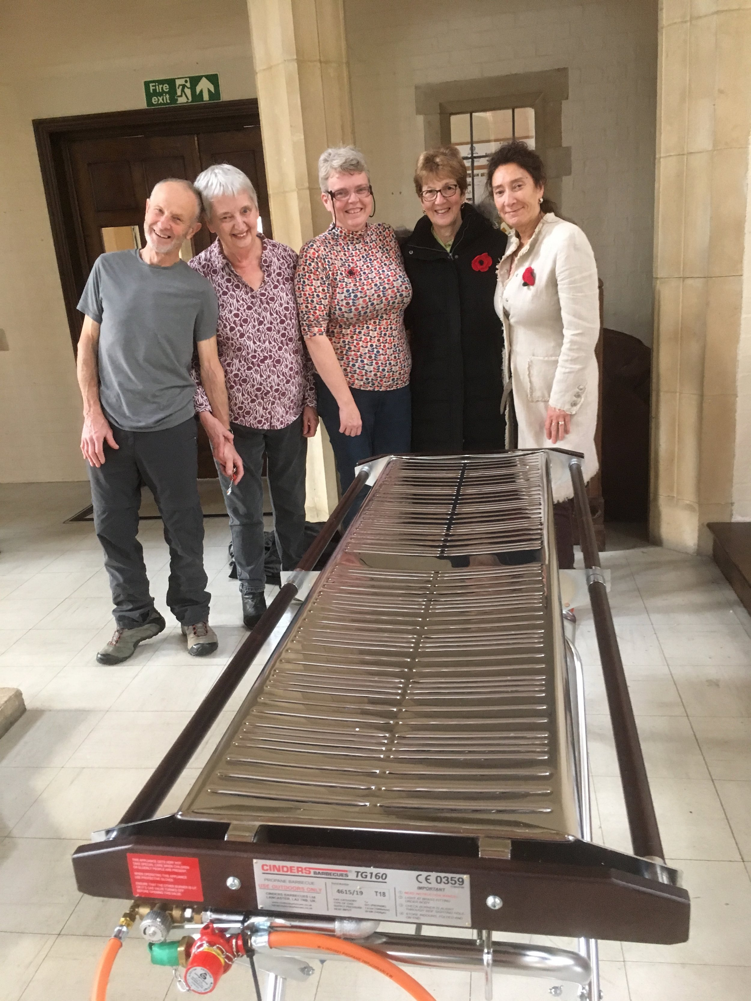 """'""""Fire it up!"""" - Members of the Social Cttee admire our new church BBQ"""