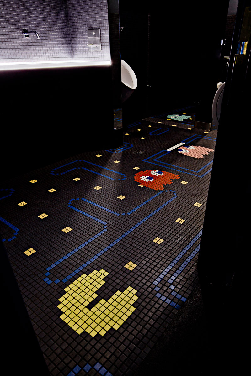 Men's restoom with Pac-Man floor tile