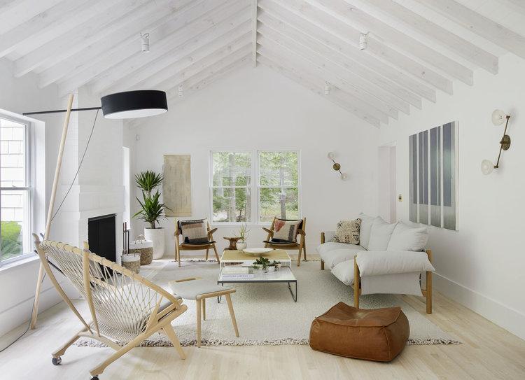 modern lamp windows open space chairs sofa plants greenery