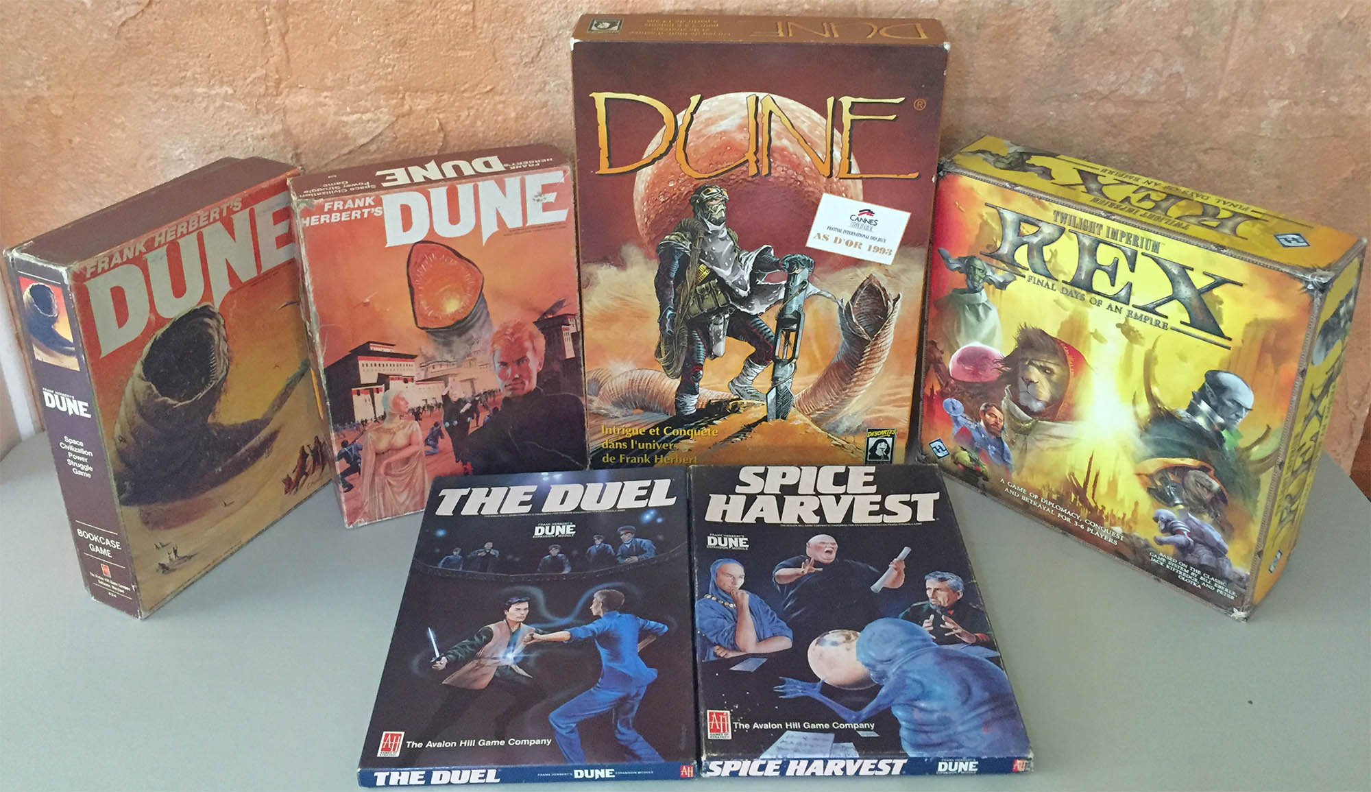Dune and Rex game boxes from 1979 - 2012