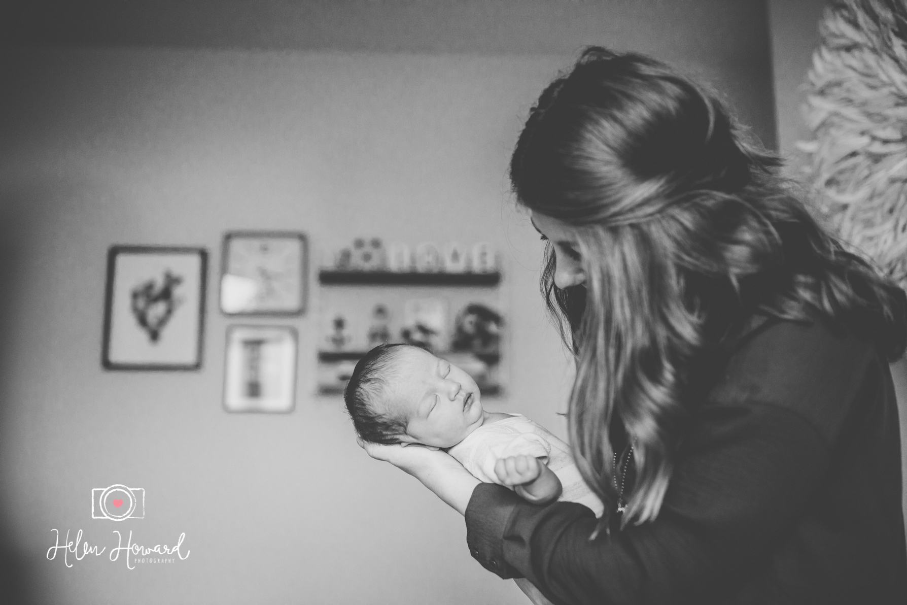 Black and white image of a mother holding her newborn baby girl
