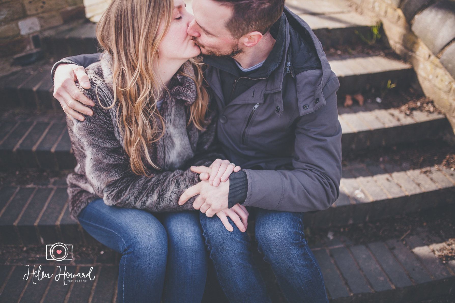Couple kissing on steps by the canal in Berkhamsted