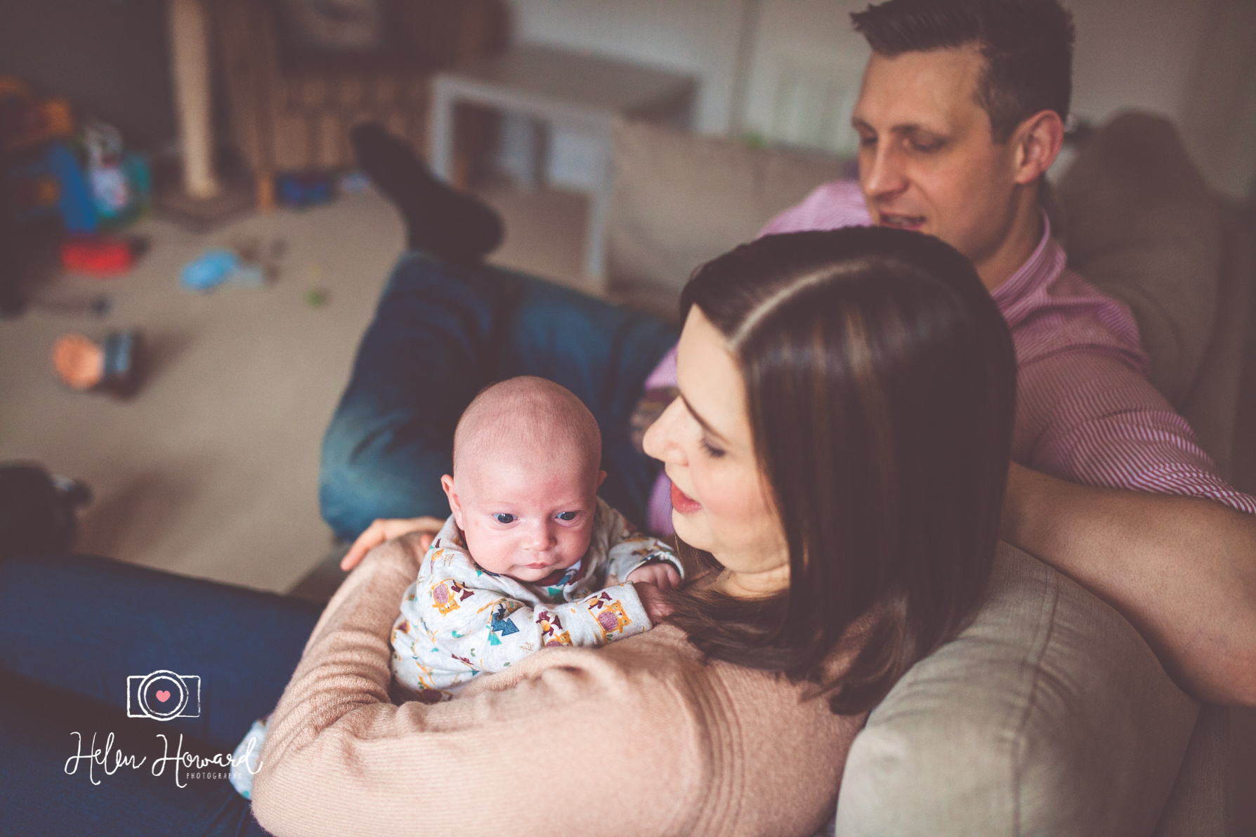 A mother and father with their newborn baby boy portrait photography by Helen Howard