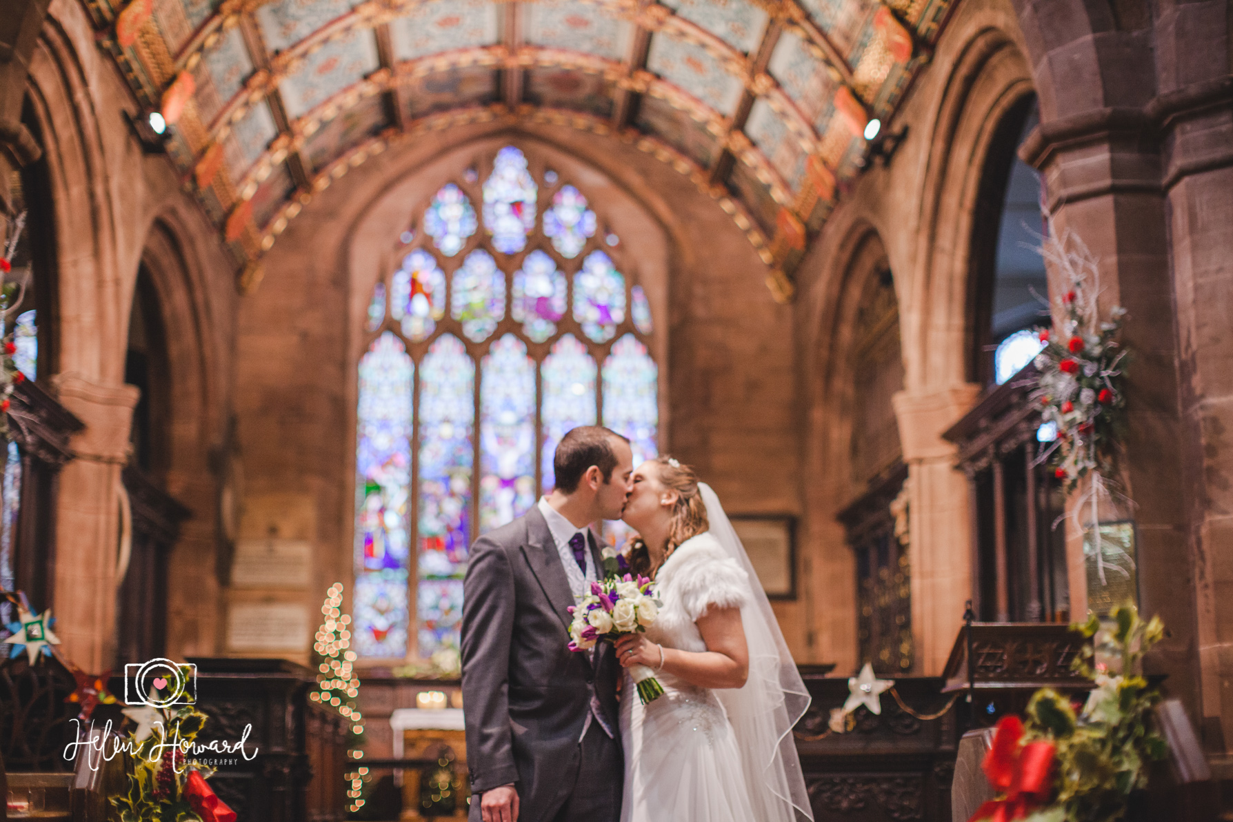 A bride and Groom kissing in the church wedding photography in Sutton Coldfield
