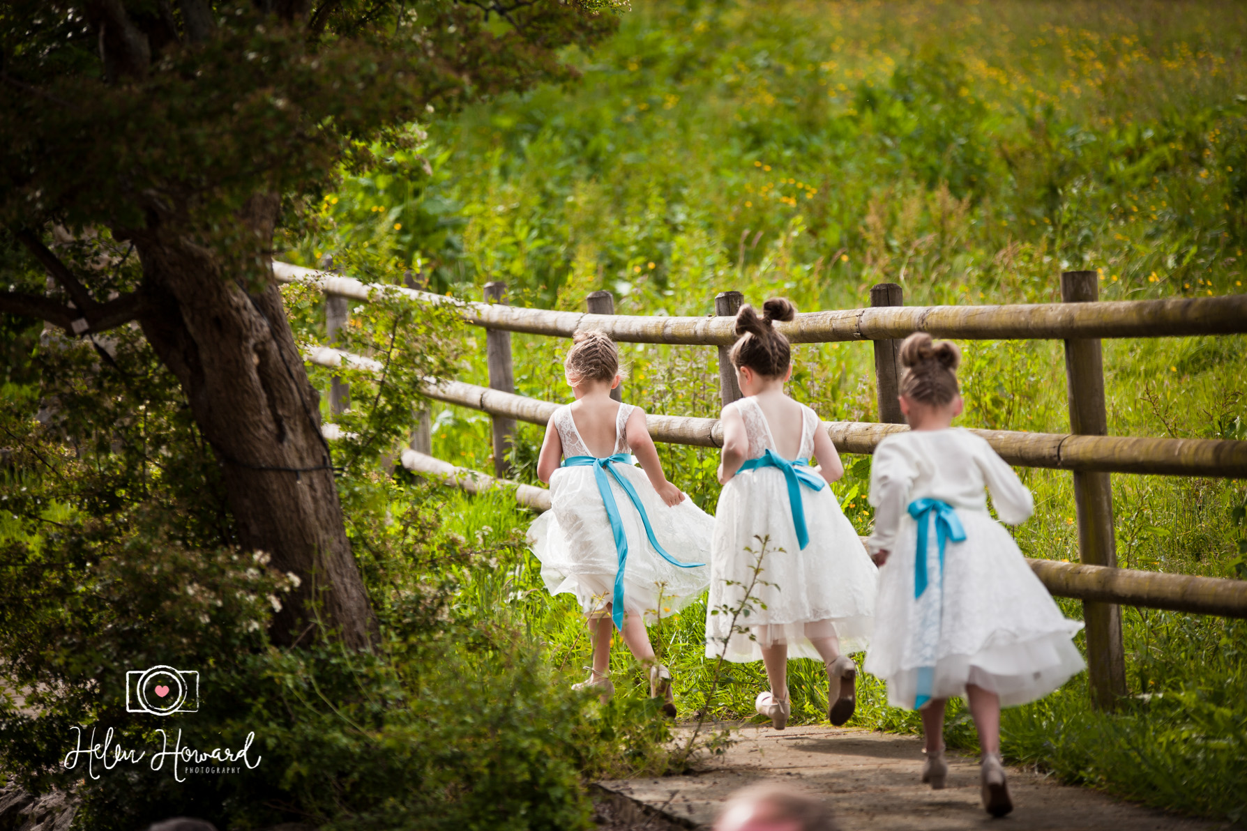 Flower girls running at  Ashes Exclusive Country house Wedding Venue Photographer
