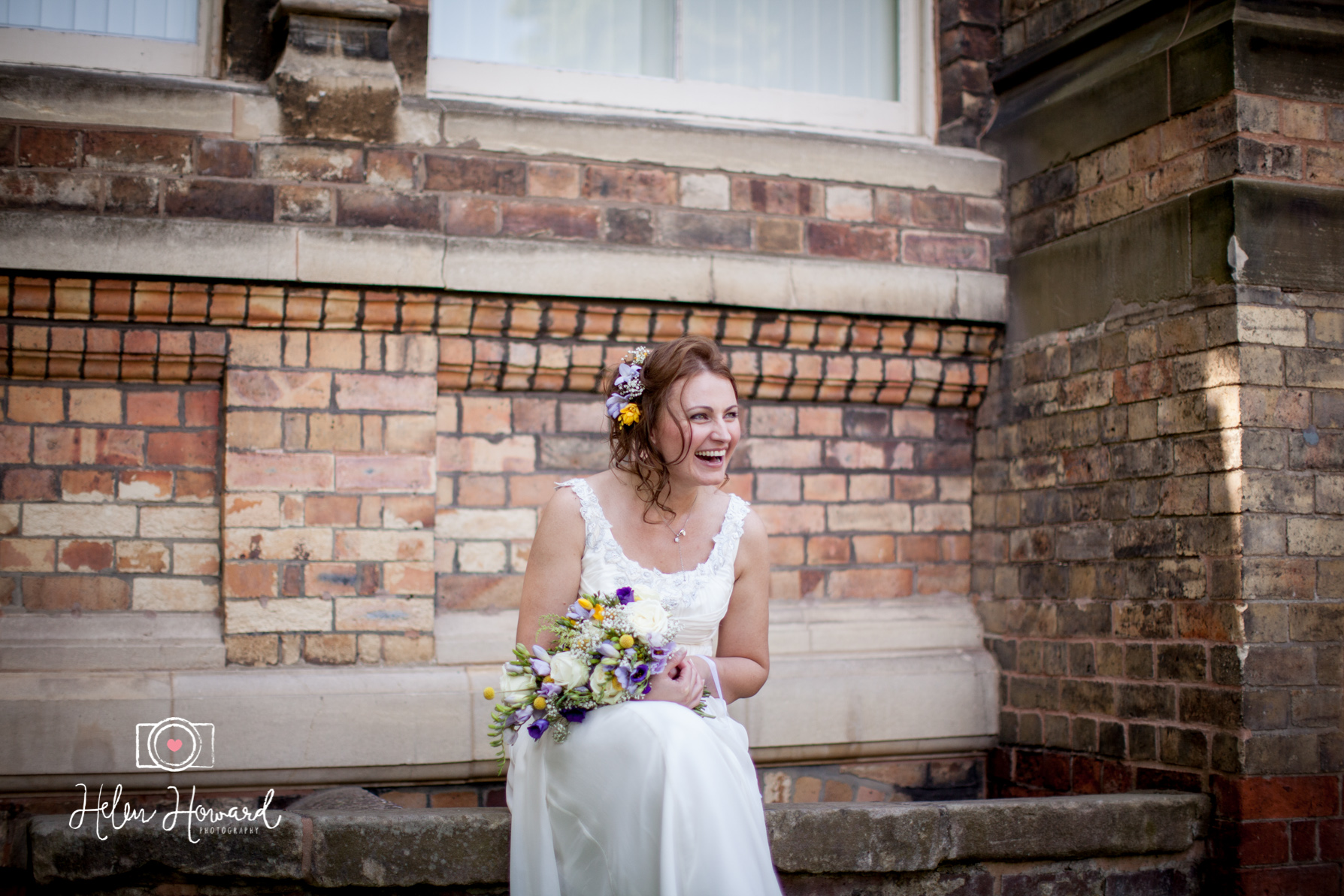 A Bride laughing at her Groom outside Lichfield Register Office