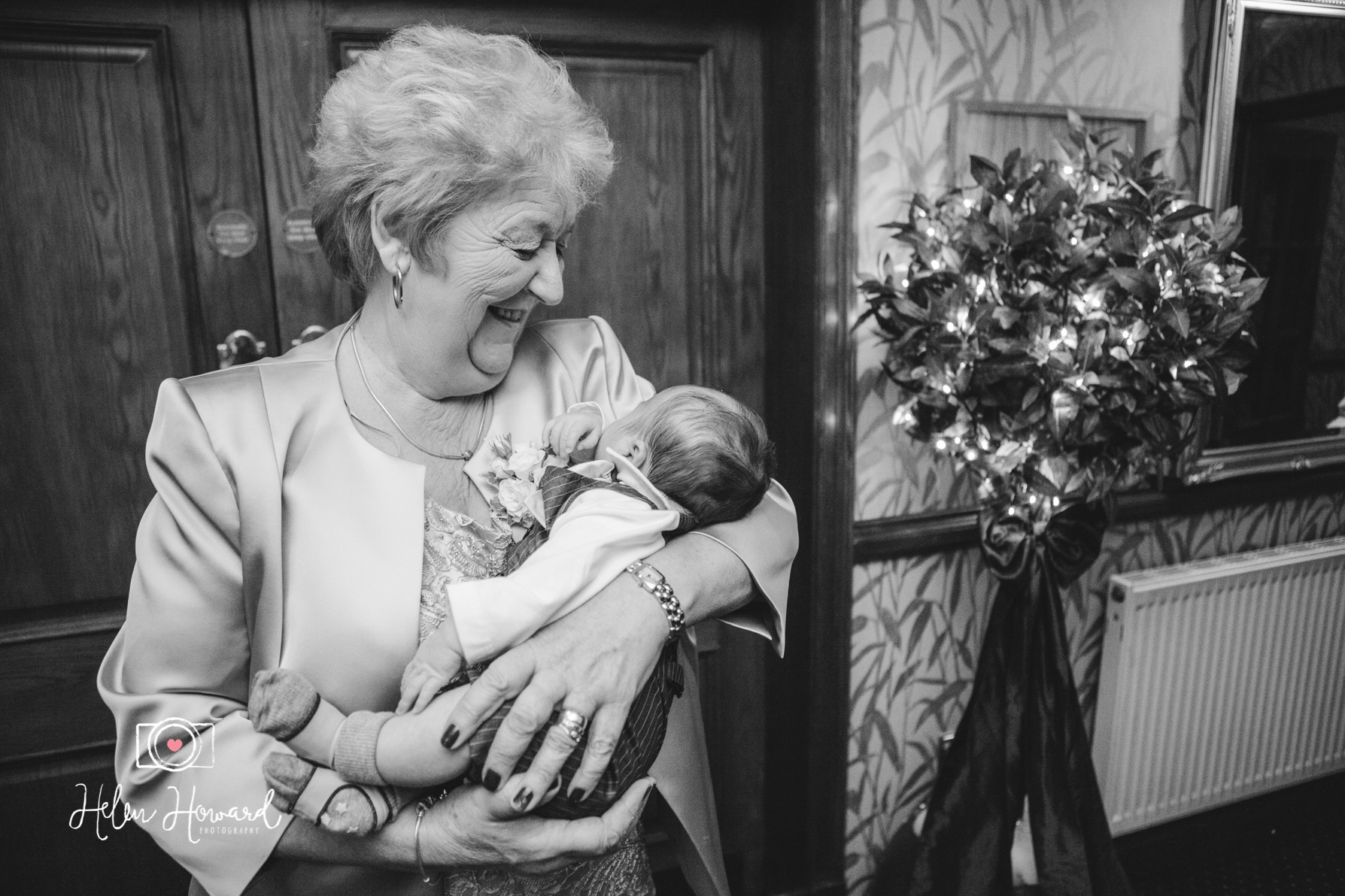 A grandmother holding her grandson at a wedding in Staffordshire