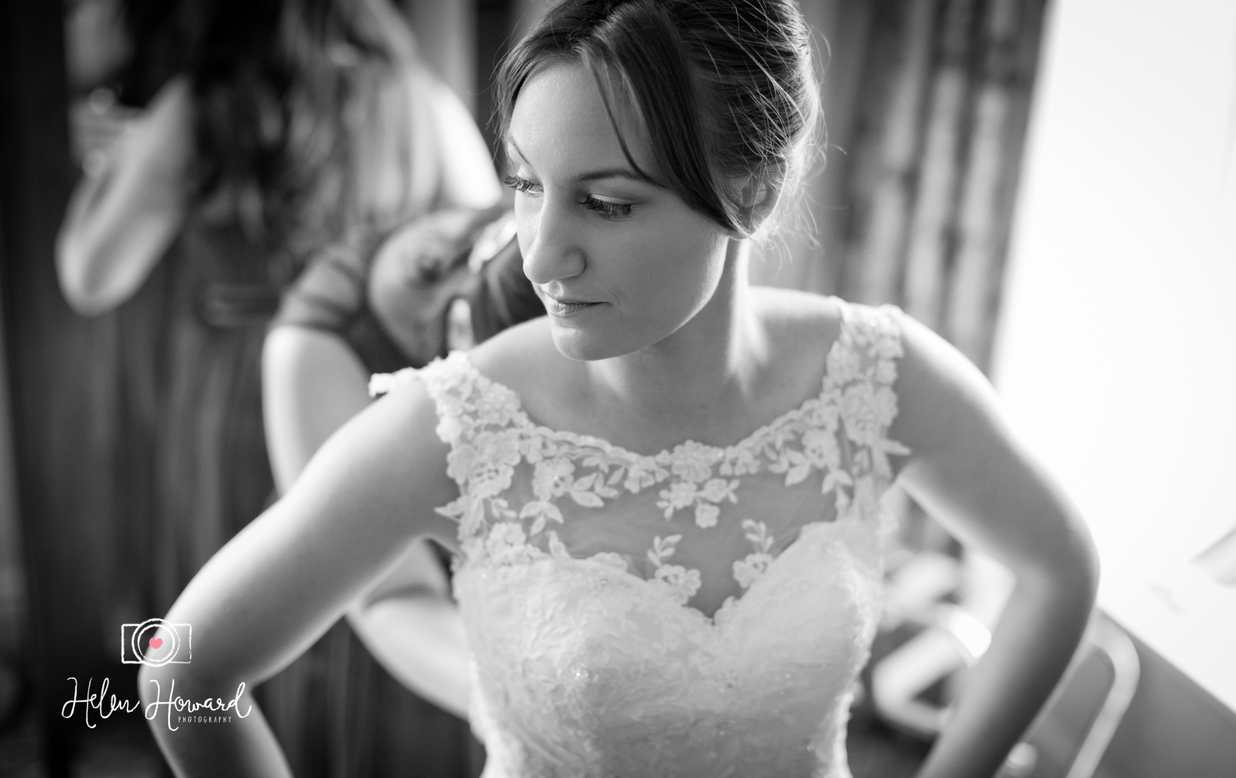 Black and white image of a bride getting ready at Shrigley Hall Wedding Photography