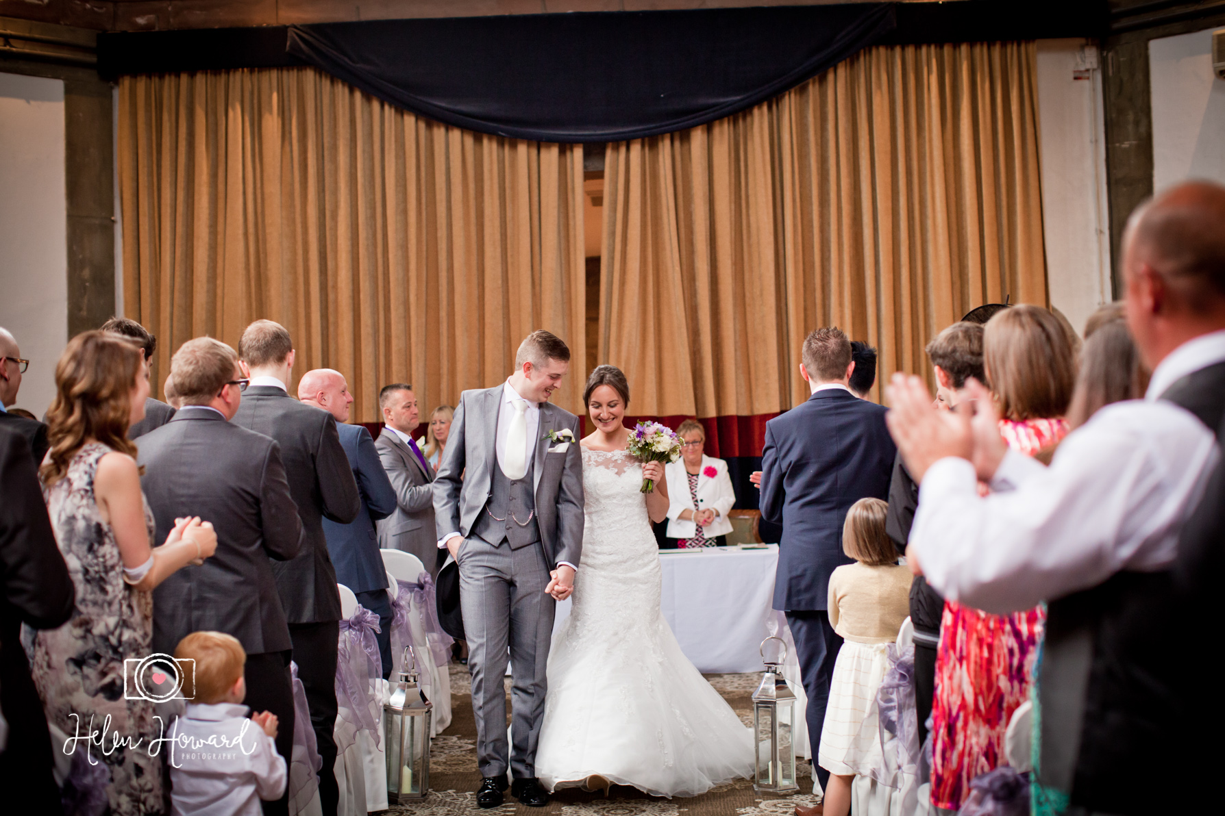 Shrigley Hall Wedding Photography bride and Groom walking down the aisle