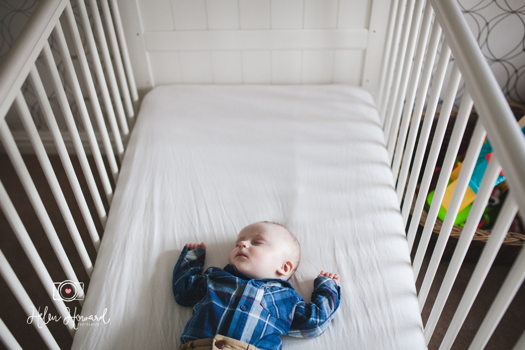 A baby boy asleep in his cot documentary family photography in Sutton Coldfield