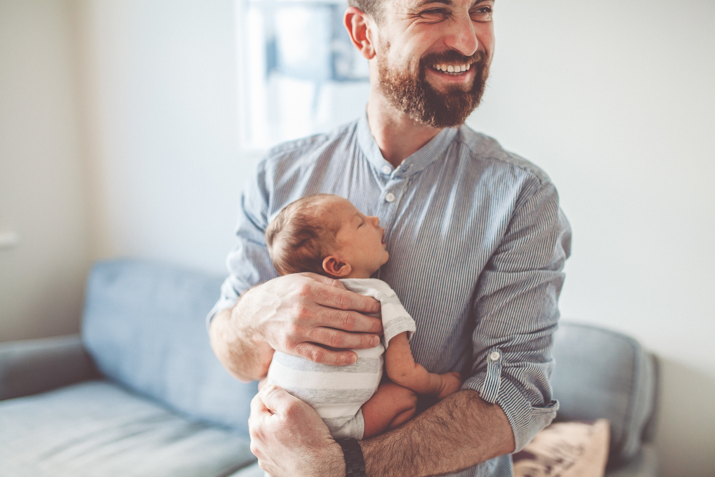 A father holding his baby son