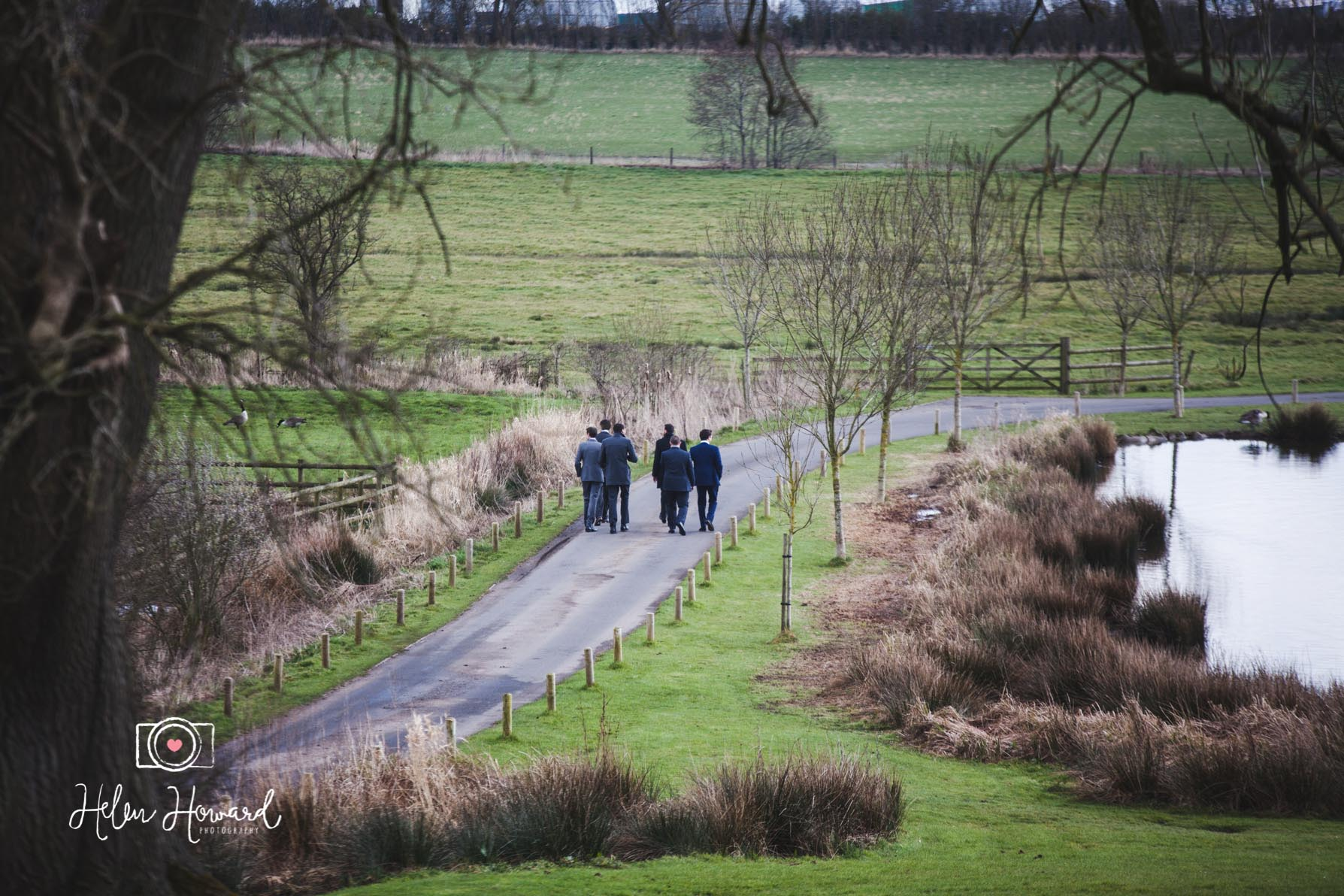 Groomsmen walking down the driveway at The Ashes Endon
