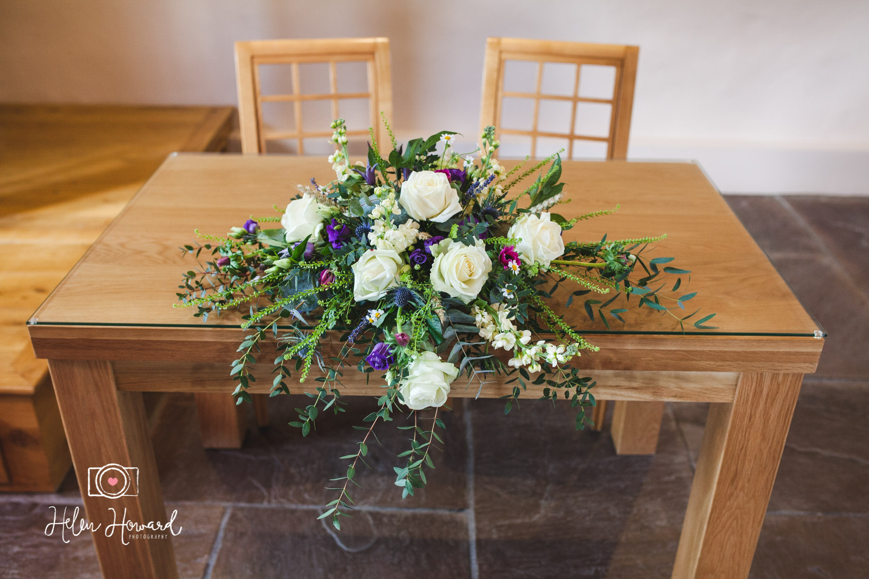 Floral display on the register signing table at The Ashes Endon