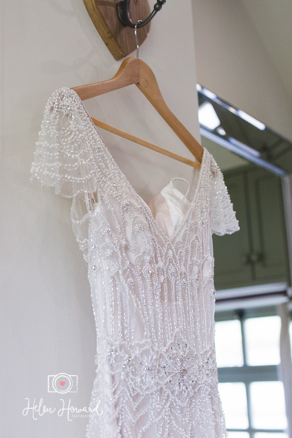 Brides Wedding Maggie Sottero Gown hanging up in The Old Dairy