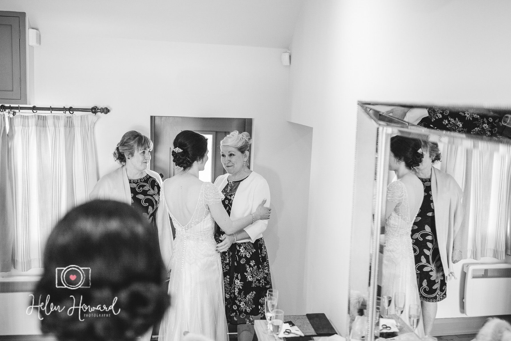 A bride talking to her mum and future mother in law