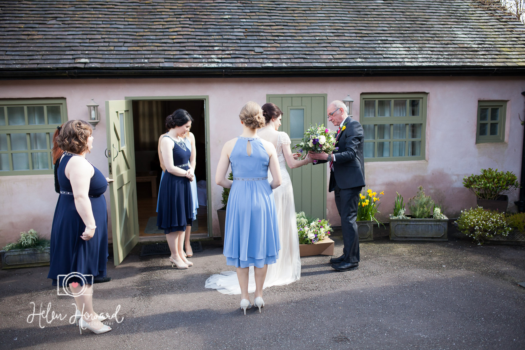 Bride, her dad and her bridesmaids leaving the old dairy for the ceremony