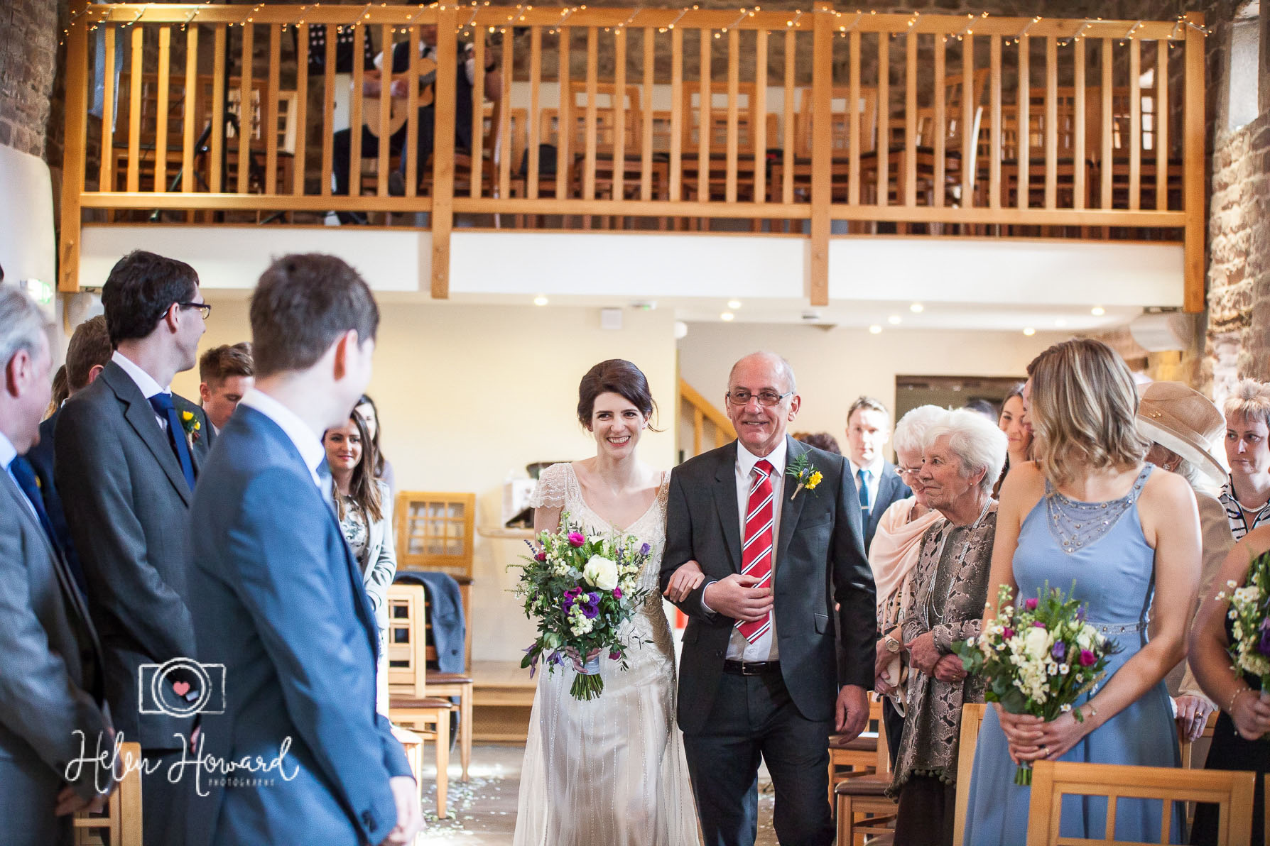 Bride walking down the aisle with her dad at The Ashes in Endon