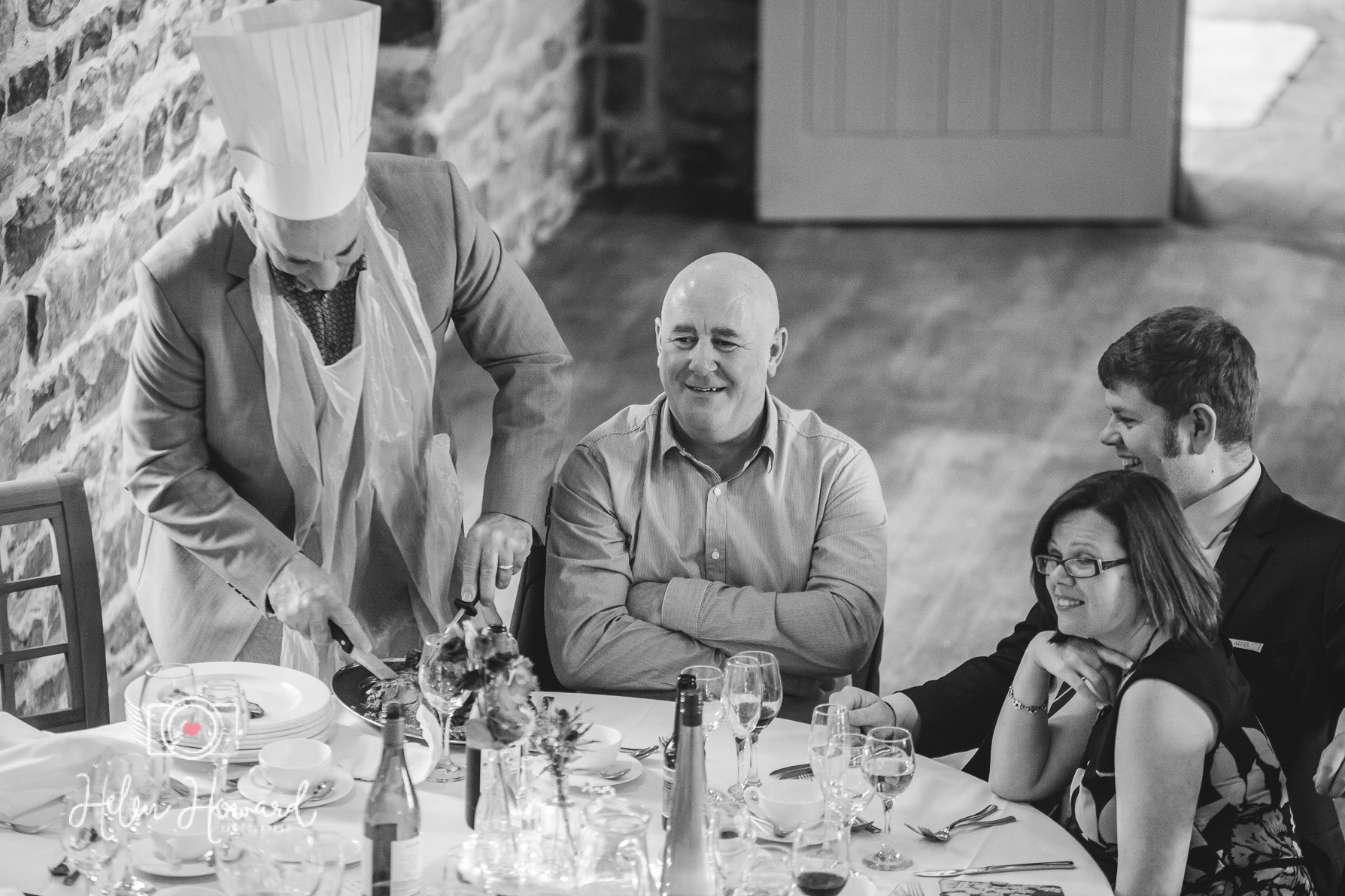 A Guest elected to carve the joint at the table staffordshire wedding photography