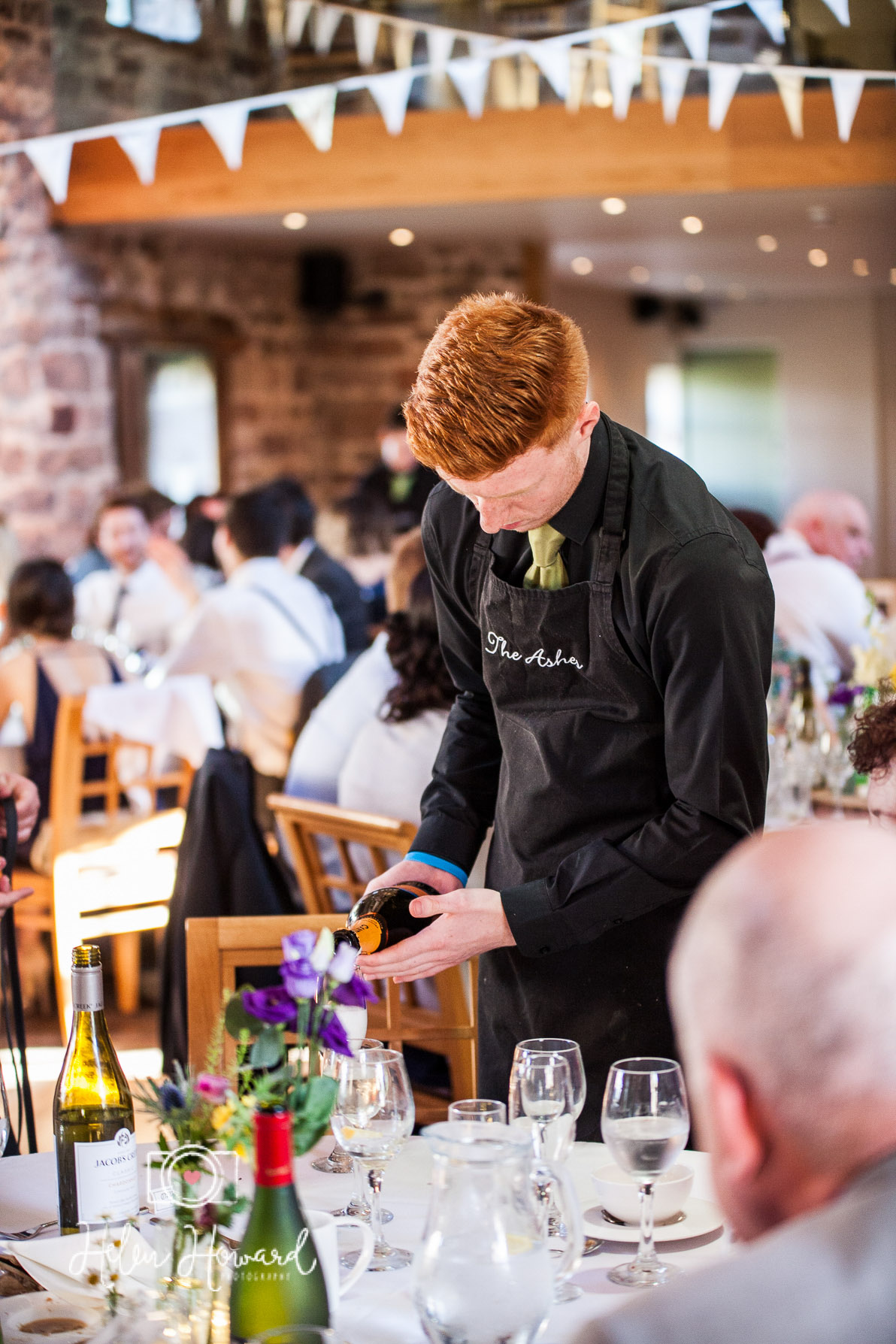 The Ashes Staff serving his table of guests