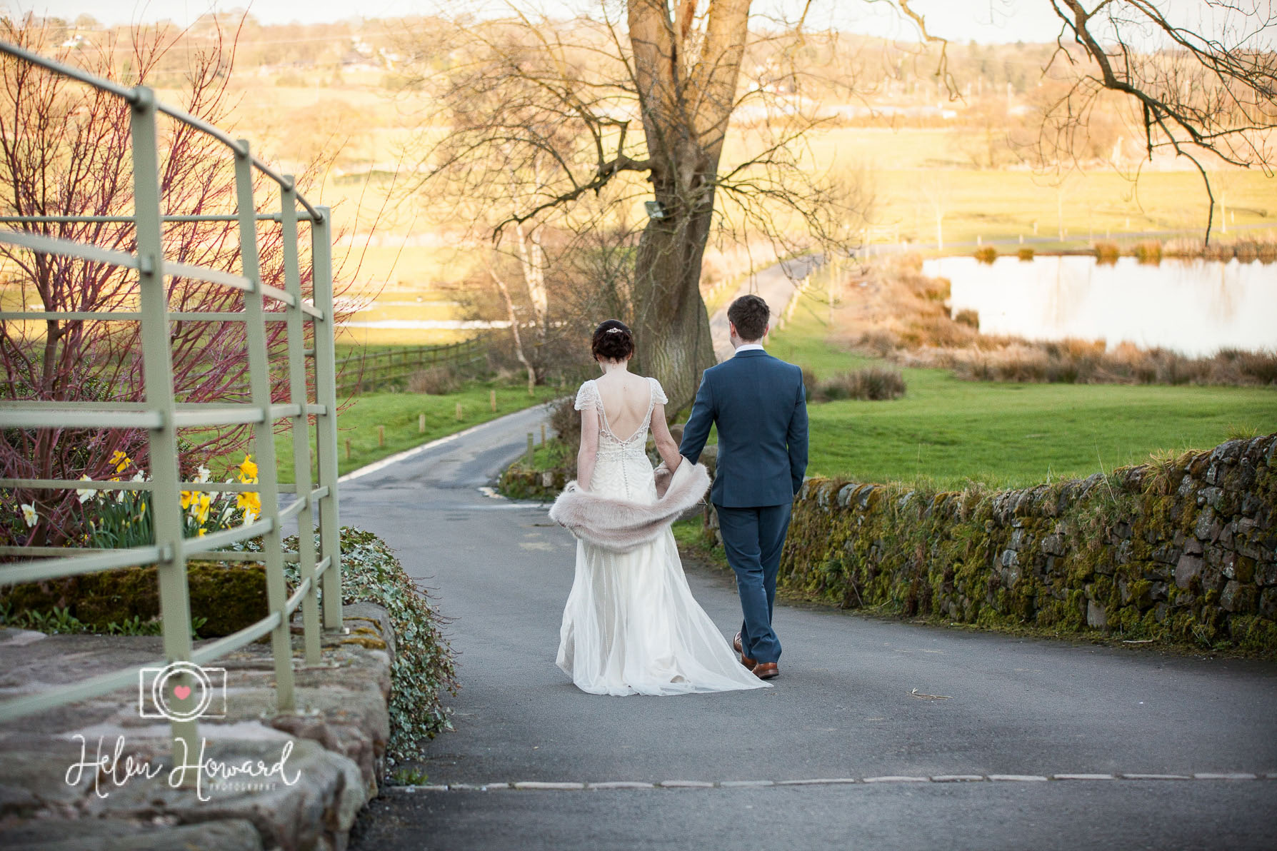 Bride and groom walking down the drive at The Ashes