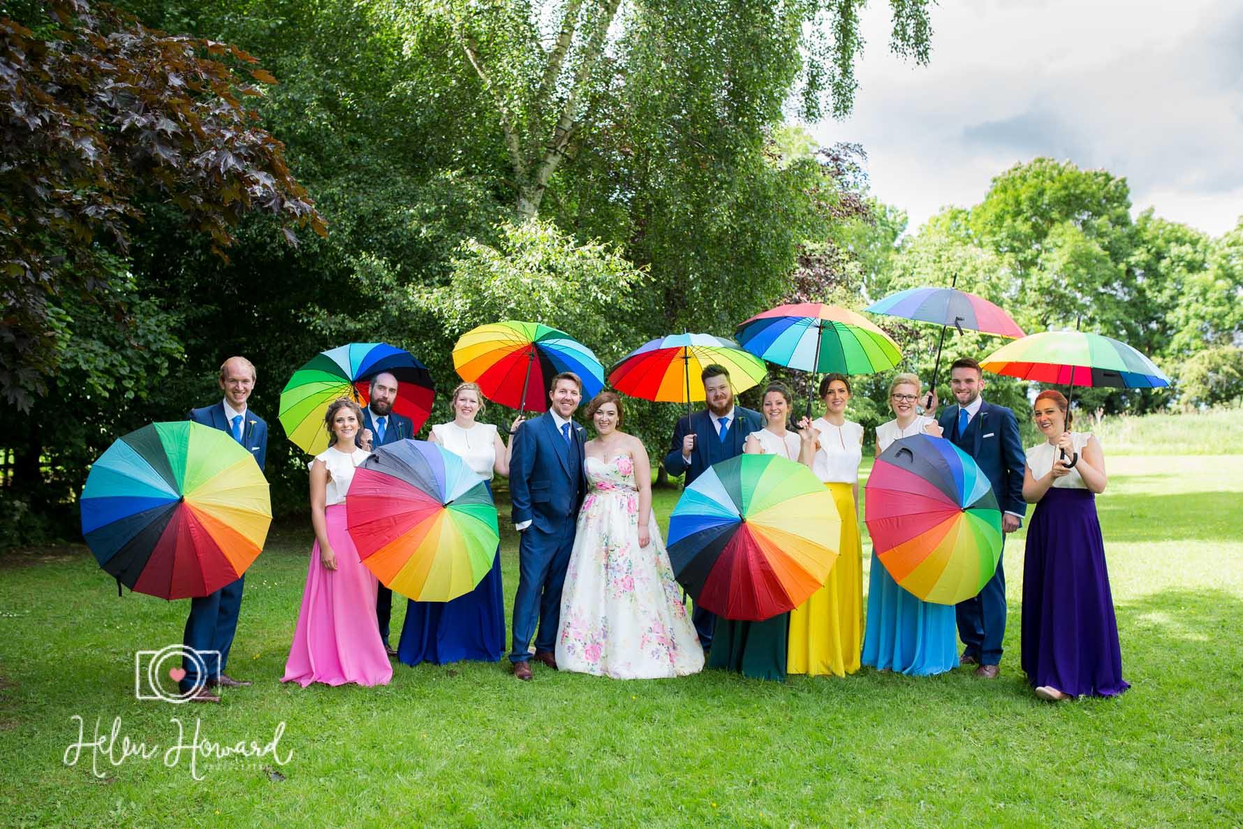 Wedding party and rainbow umbrellas