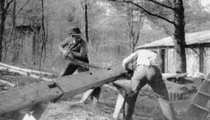 Lincoln County Rifle Club members saw lumber for their clubhouse circa 1935.