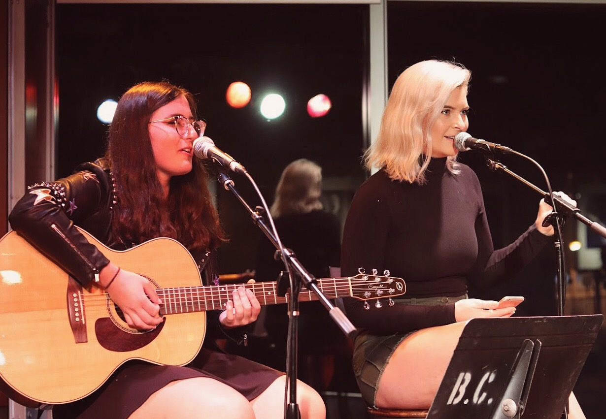 Pictured above: Belmont songwriters Shir Czopp and Cheyenne Arnspiger hosting a writers round at Curb Cafe