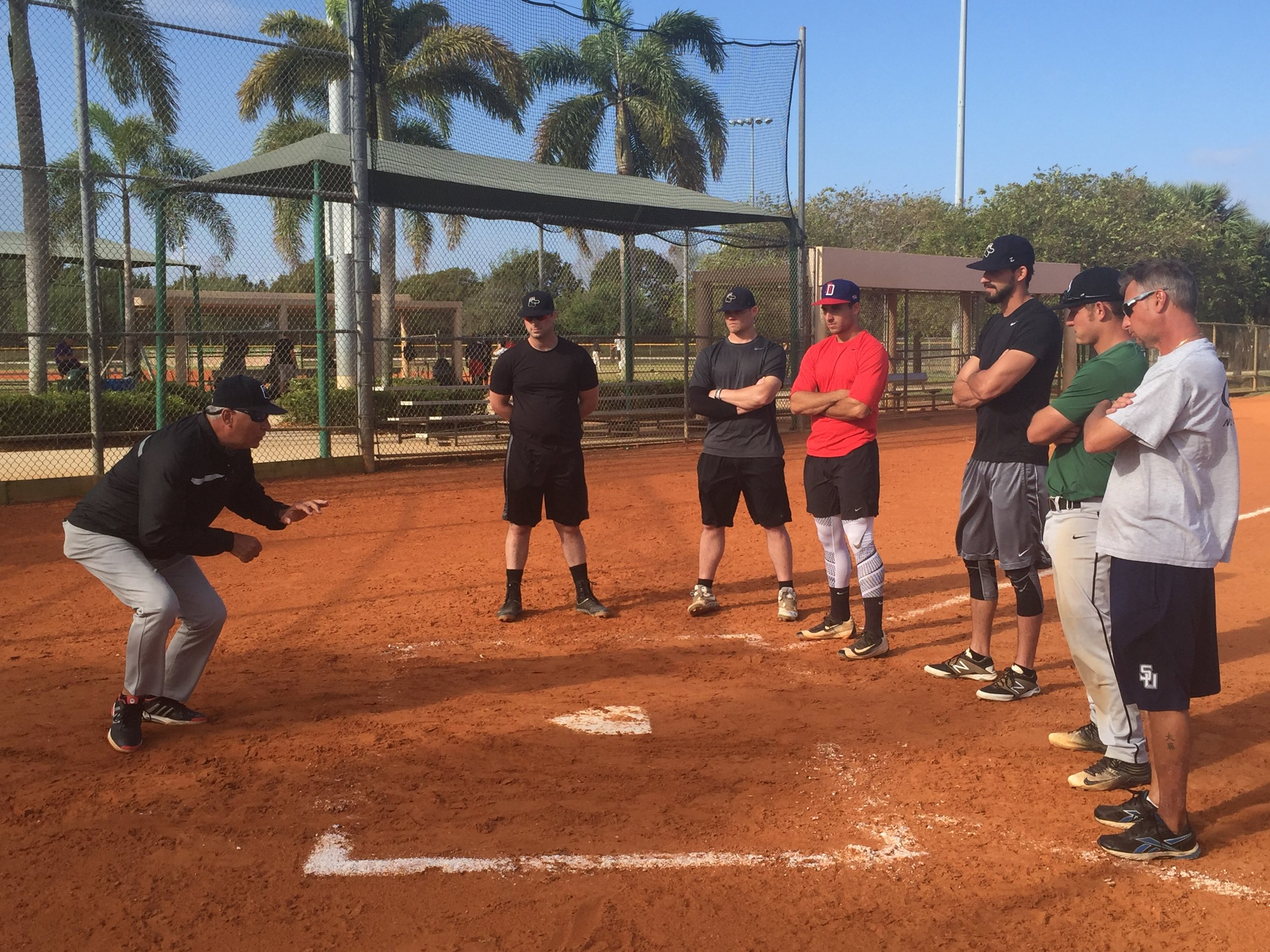 Professional Manager Carlos Lezcano working with Catchers at early workout.