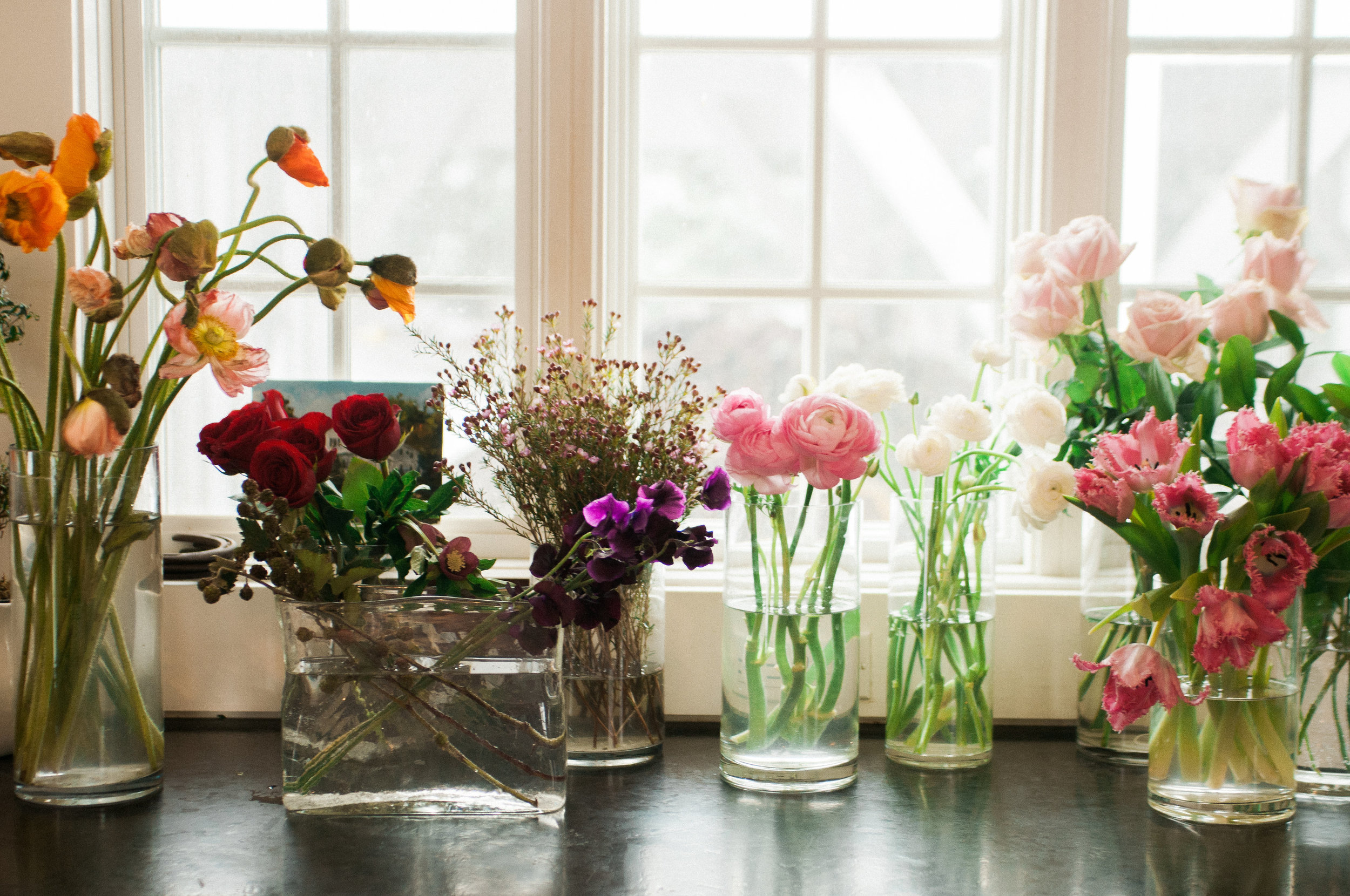 Little pops of color.  Floral Design by Poppies.  Photo by Meg Manion Photography.