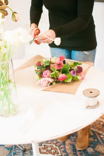 Tulips and not just any tulips.  Fringe tulips! Hellebores, ranunculus, blackberries, sweet peas and geranium leaves just to name a few of the ingredients featured here.  Floral Design by Poppies.  Photo by Meg Manion Photography.