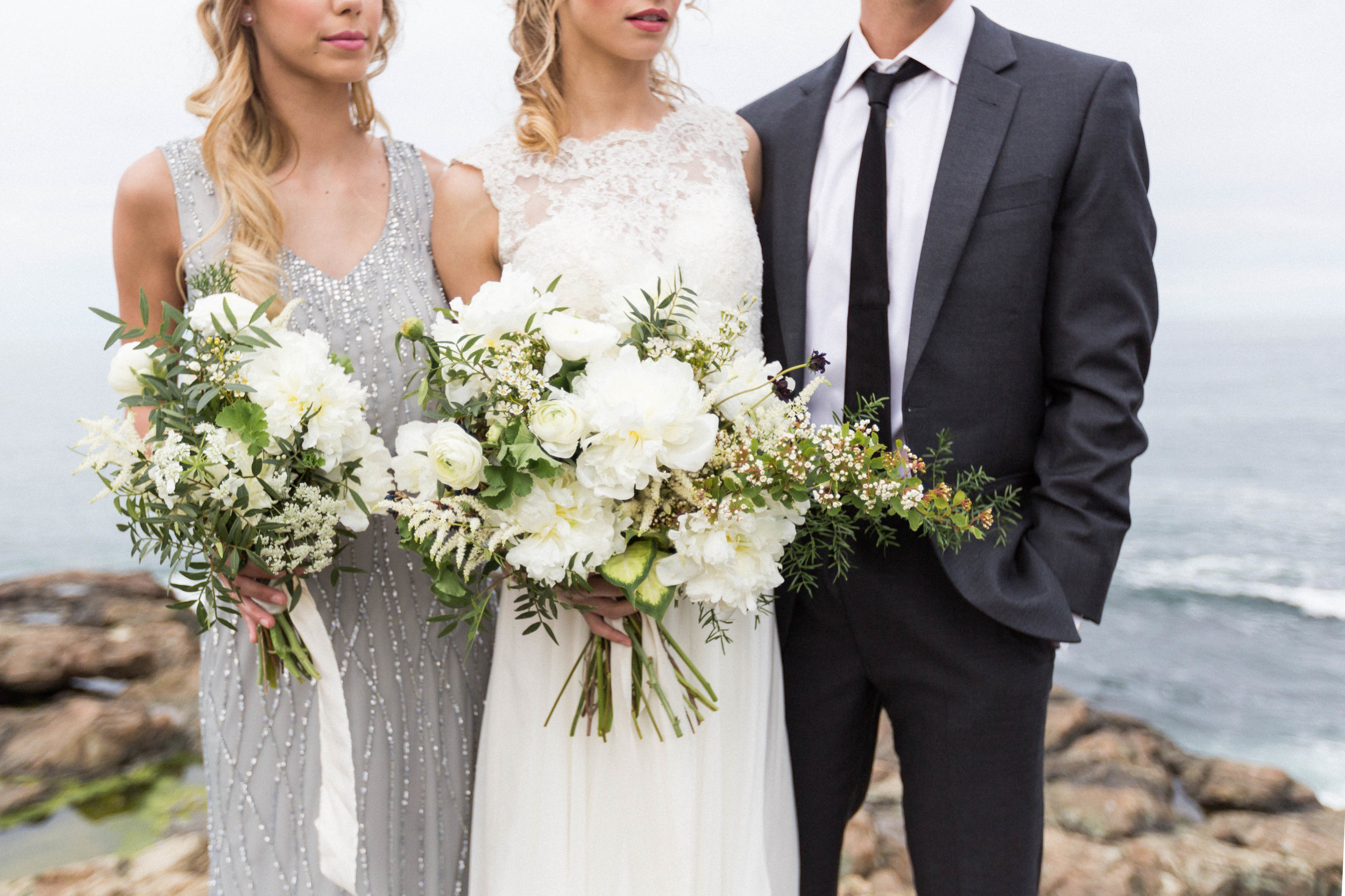 http://www.poppiesflowerdesign.com     Bridal and bridesmaids bouquets. Photograph by KAngell Photography.