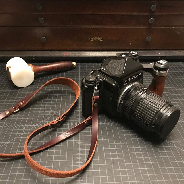 Although the option is not on our website, if you ask nicely we'll make you a custom leather strap for your Pentax 67 or Hasselblad CM.