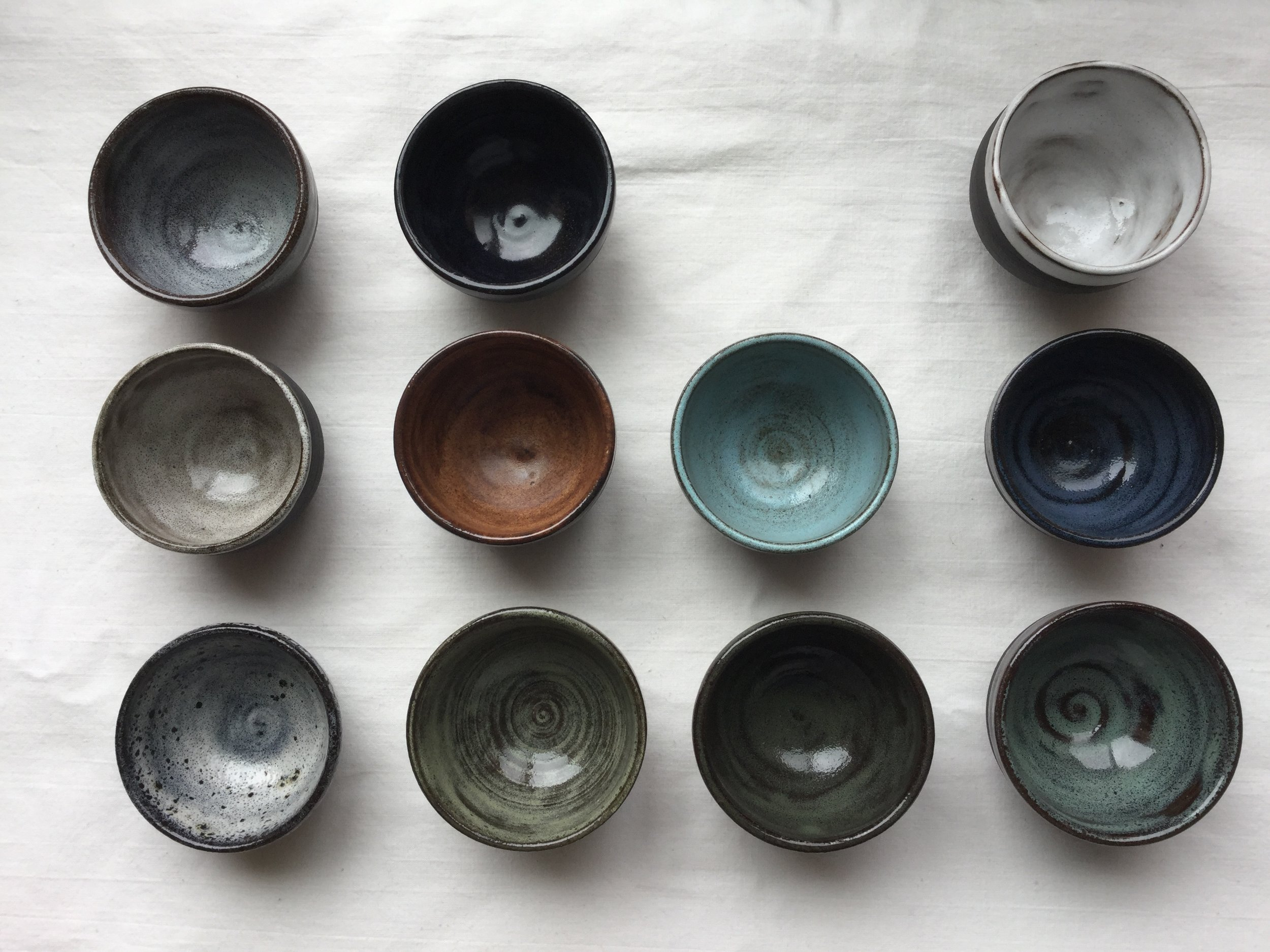 from left to right (on black clay)  Ocean, Black, Snow white  Sugar white, Wood, Powder blue, Denim blue  Midnight ocean, Honeydew mint, Dark green, Blue green