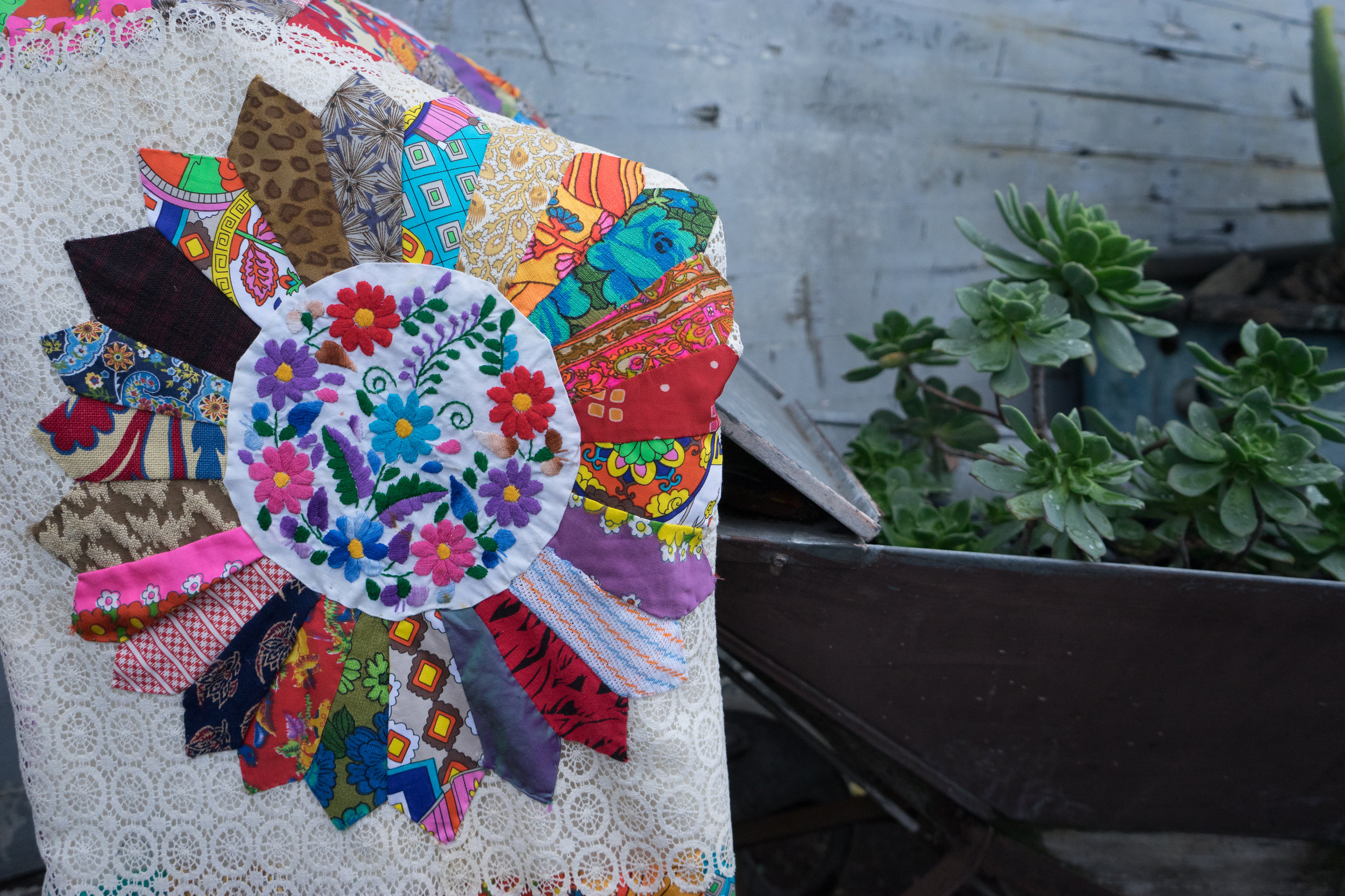 """""""First Flowers"""" My first quilt, 100% hand sewn and made from scraps.Boredom of a broken hand and physical therapy led to me hand sewing my first quilt. 2014."""
