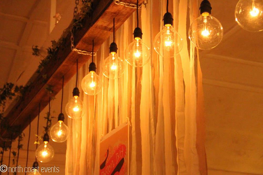 Rustic timber beam lighting installation