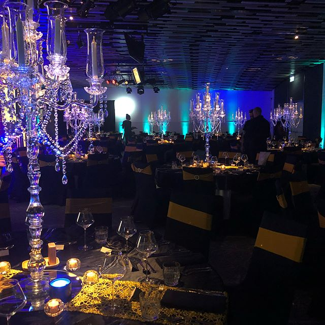 A very fancy gala dinner with a pirate ship stage #setdesign #stagedesign #eventlighting #lighting
