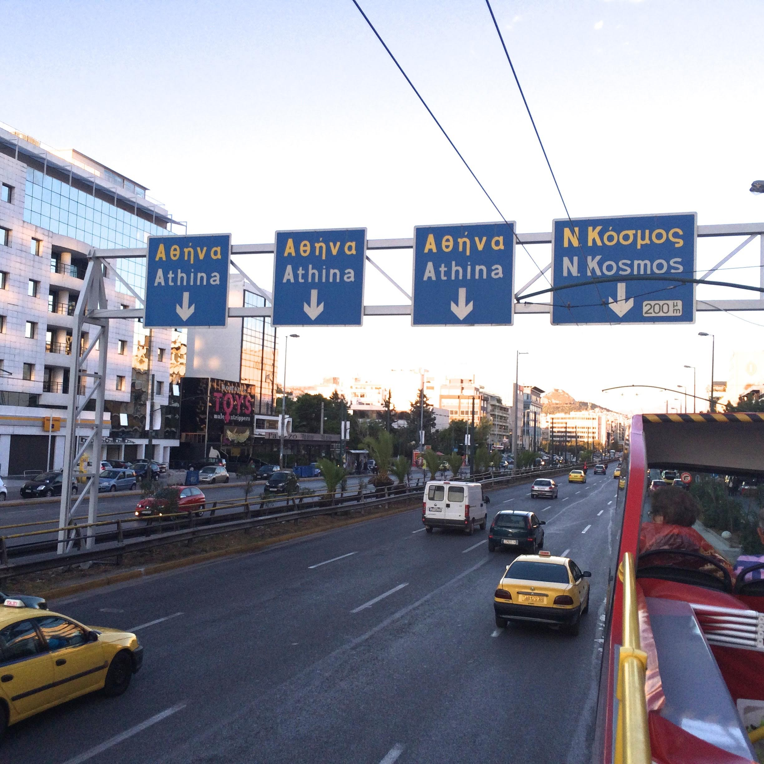 On the busy freeway in the cosmopolitan section of Athens.