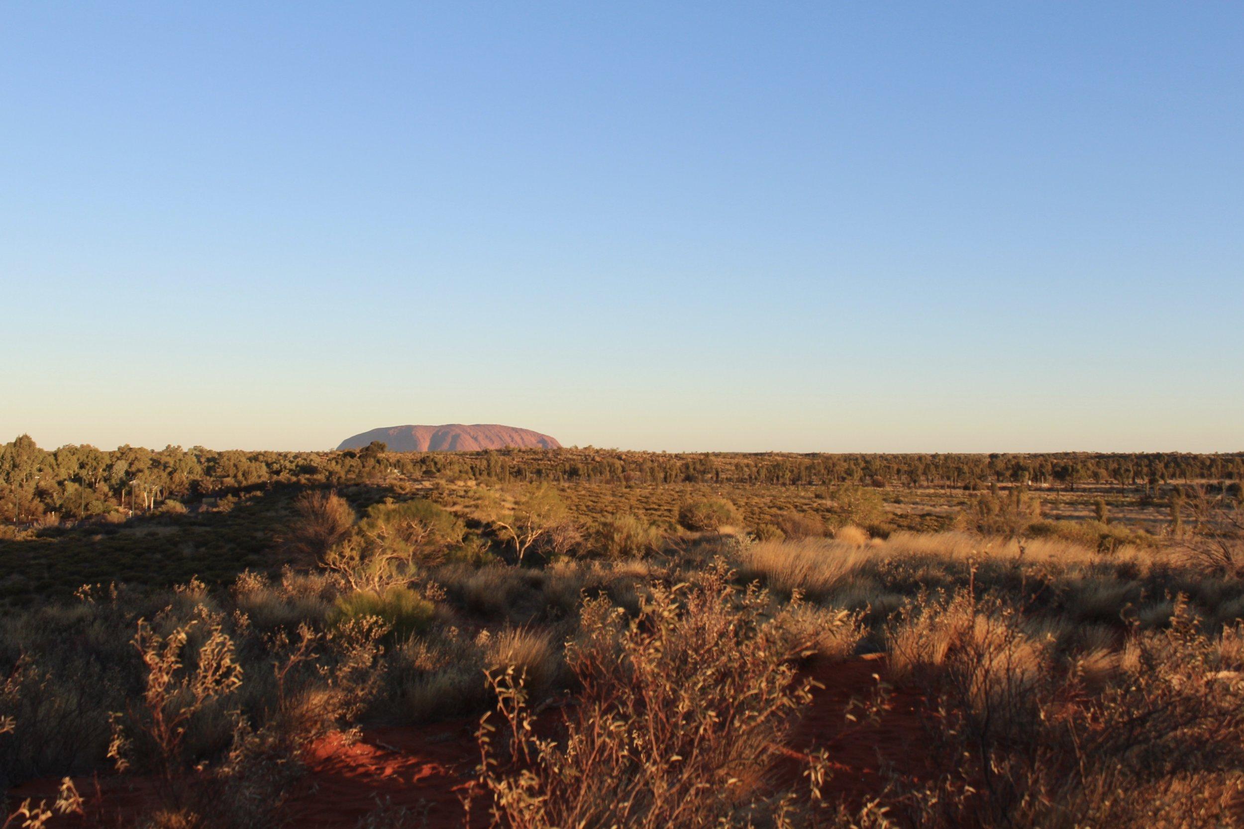 Uluru in the distance