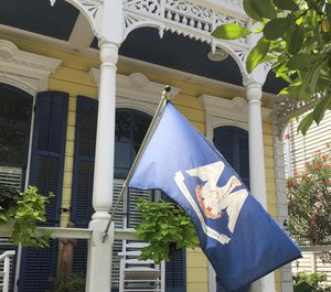 Louisiana state flag on yellow house porch.jpg