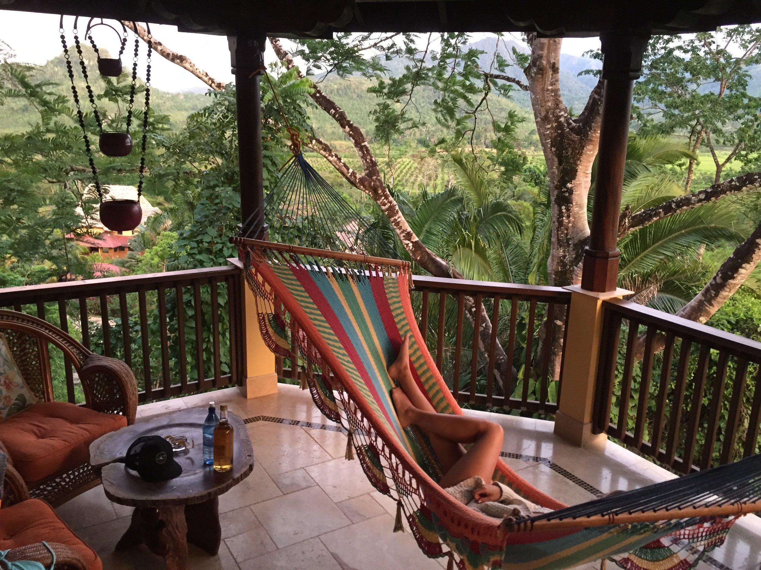 Multi-colored hammock on balcony overlooking jungle.JPG