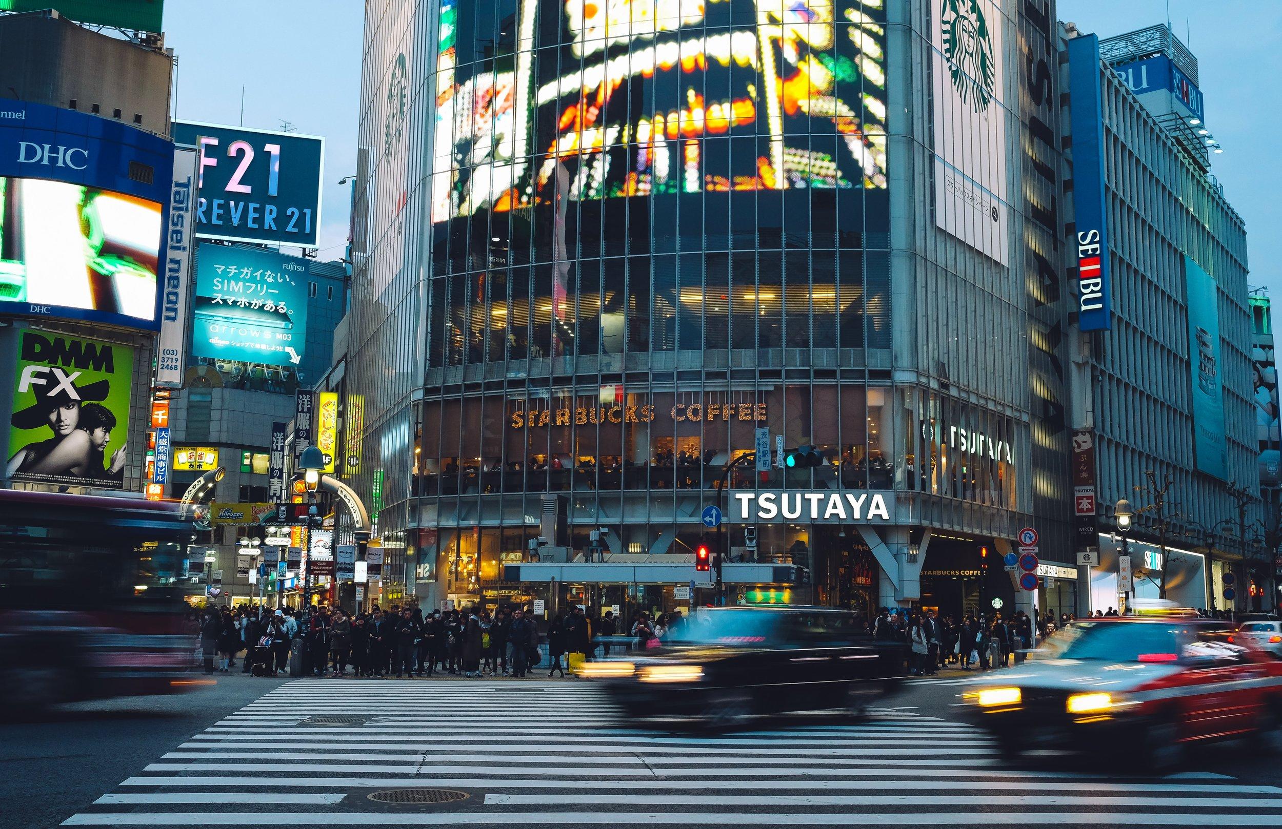 cars passing by on street in japan.jpg