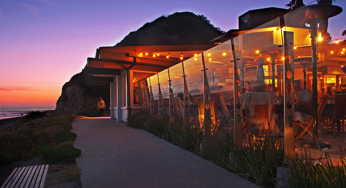 Oceanfront dining at Boathouse at Hendry's Beach. Photo via boathousesb.com