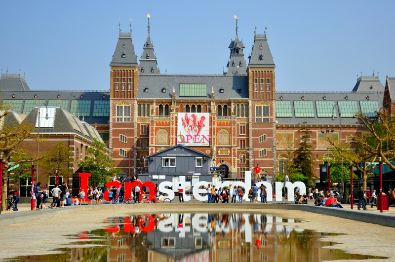 Museum Square facing the Rijksmuseum, with the IAMSTERDAM Sign up front.