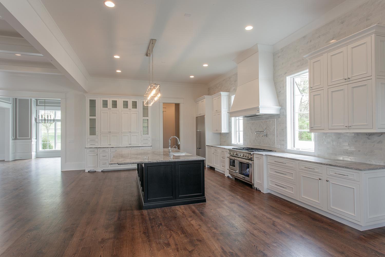 custom-built-home-forest-hills-nashville-tennessee-chandelier-development-open-living-white-kitchen-natural-light-master-bathroom22.jpg
