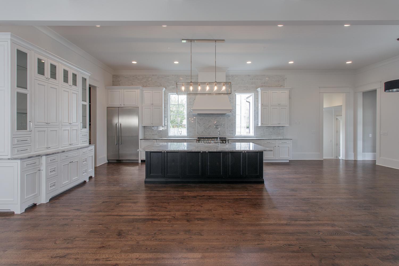 custom-built-home-forest-hills-nashville-tennessee-chandelier-development-open-living-white-kitchen-natural-light-master-bathroom19.jpg