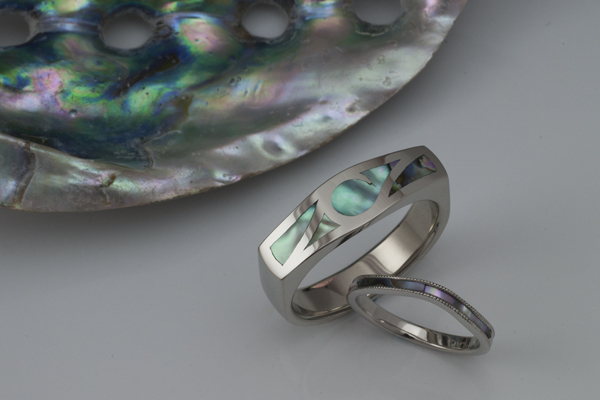 White gold rings inlaid with Abalone shell provided by the couple from a memorable trip.