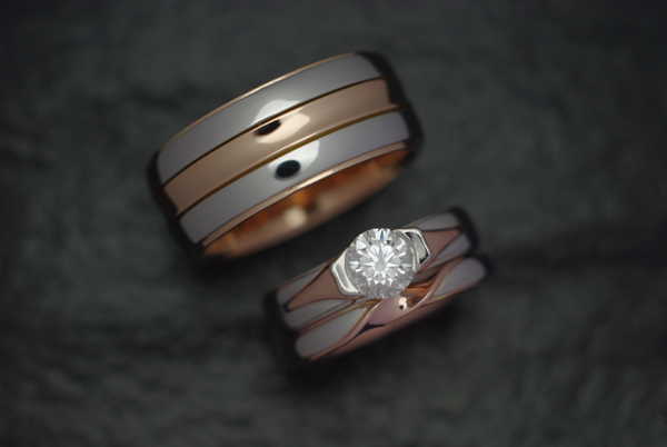 Two tone white and red gold set.  Her band features a twisting effect.