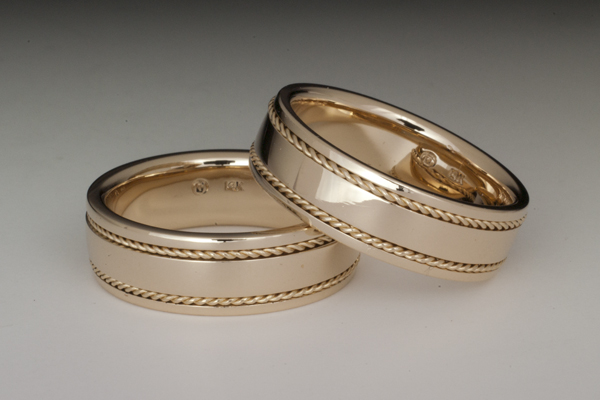 Matching yellow gold mens' bands with inlaid twisted wire.