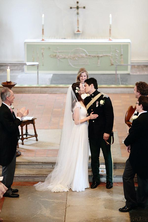 Surrey-wedding-photographer-first-kiss.jpg