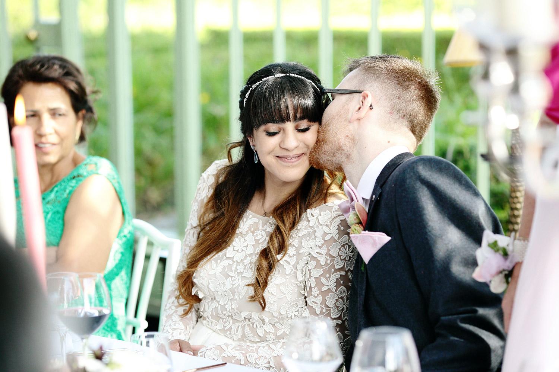 bride and groom kissing cliff at lyons wedding photo